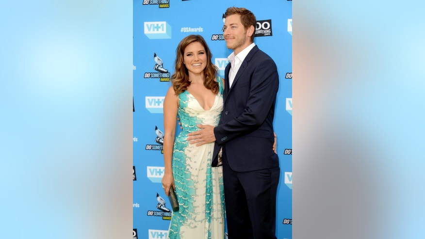 July 31, 2013: Sophia Bush, left, and Dan Fredinburg arrive at the Do Something Awards at the Avalon in Los Angeles. Fredinburg, a Google executive who described himself as an adventurer, was among the hundreds who died in a massive earthquake that struck Nepal.