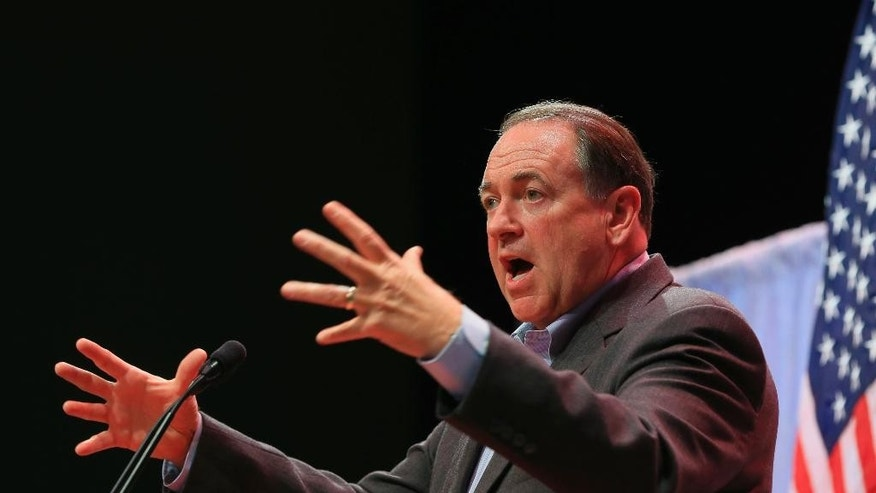 Former Arkansas Governor Mike Huckabee speaks at the Iowa Faith & Freedom 15th Annual Spring Kick Off, in Waukee, Iowa, Saturday, April 25, 2015. (AP Photo/Nati Harnik)