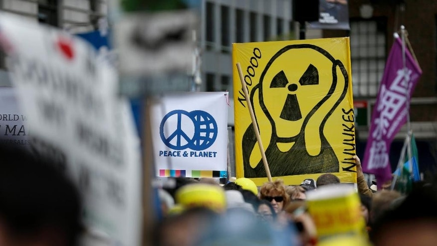 People hold signs during an anti-nuclear rally in Union Square in New York, Sunday, April 26, 2015. This year marks the 70th anniversary of the United States using nuclear bombs on Hiroshima and Nagasaki in Japan. (AP Photo/Seth Wenig)