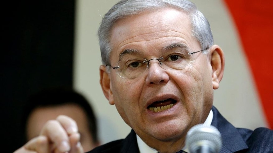 "FILE - In this Dec. 5, 2014 file photo, Sen. Robert Menendez, D-N.J. speaks in Secaucus, N.J. Senate proponents of a bill empowering Congress to review and potentially reject any Iran nuclear deal must first win a battle with some colleagues determined to change the legislation in ways that could sink it. ""Anybody who monkeys with this bill is going to run into a buzz saw,"" Republican Sen. Lindsey Graham of South Carolina warned ahead of this week's debate. Also trying to discourage any changes, Democratic Sen. Bob Menendez of New Jersey urged senators to stick with the plan as it emerged from the Senate Foreign Relations Committee.  (AP Photo/Julio Cortez, File)"