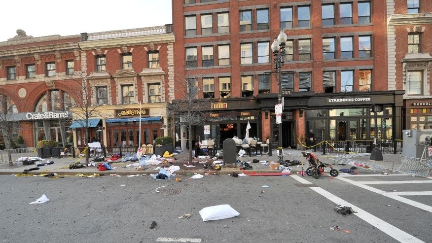 This April 15, 2013 forensics photograph made by the FBI, and provided Thursday, April 23, 2015, by the U.S. Attorney's office, and presented in federal court as evidence during the penalty phase of convicted Boston Marathon bomber Dzhokhar Tsarnaev's trial, shows the scene where the second bomb exploded on Boylston Street near the marathon finish line in Boston. Three people were killed and more than 260 others were wounded when twin bombs exploded. The prosecution rested its case Thursday during the penalty phase of Boston Marathon bomber Dzhokhar Tsarnaev's trial after playing a video showing a mother crouched over her 8-year-old son and resting her head on his chest as he lay dying. (U.S. Attorney's Office via AP)