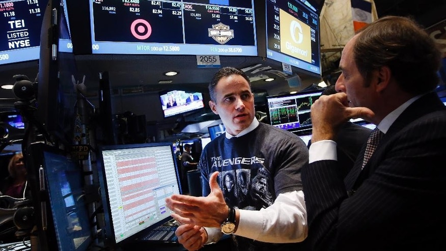 A trader wearing an Avengers t-shirt works on the floor of the New York Stock Exchange, Monday, April 27, 2015, in New York. Actors Jeremy Renner and Robert Downey Jr. rang the NYSE opening bell Monday with representatives from Marvel Entertainment. (AP Photo/Jason DeCrow)