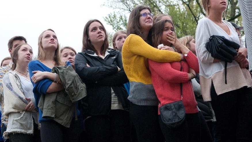 Students mourn the loss of Hannah Wilson during a vigil Saturday, April 25, 2015  in Bloomington, Ind. Daniel E. Messel, 49, of Bloomington, was arrested Friday in the death of 22-year-old IU senior Hannah N. Wilson, said State Police Sgt. Curt Durnil. A coroner said Saturday that Wilson was beaten to death.(Haley Ward/The Herald-Times via AP)