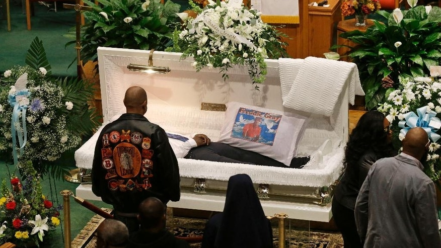 Mourners view the body of Freddie Gray before his funeral at New Shiloh Baptist Church, Monday, April 27, 2015, in Baltimore. Gray died from spinal injuries about a week after he was arrested and transported in a Baltimore Police Department van. (AP Photo/Patrick Semansky)