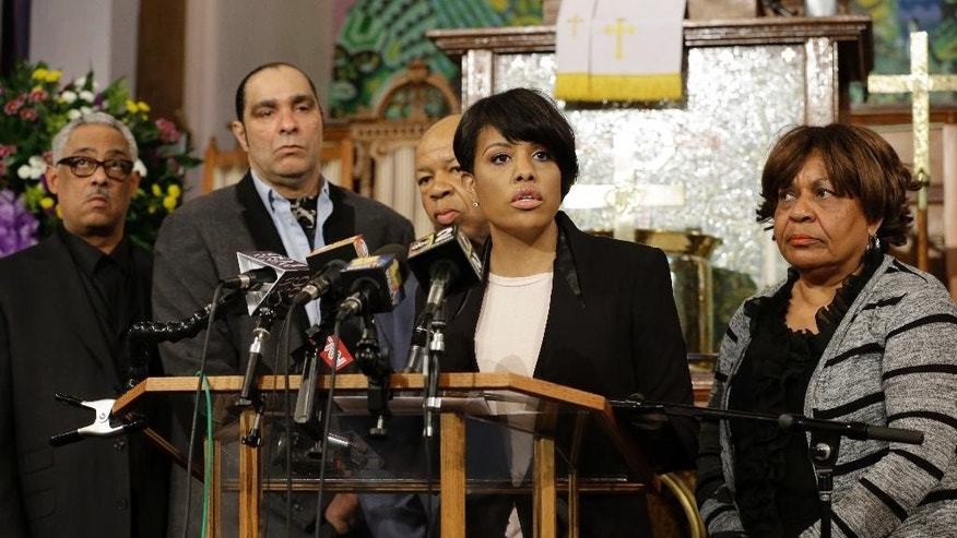 Baltimore Mayor Stephanie Rawlings-Blake speaks in front of faith and community leaders at a news conference calling for peace in response to a Freddie Gray protest that turned violent, Sunday, April 26, 2015, at the Bethel AME Church in Baltimore. Gray died from spinal injuries about a week after he was arrested and transported in a police van. (AP Photo/Patrick Semansky)