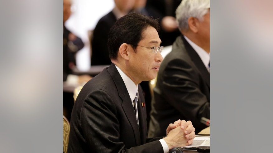 Japanese Foreign Minister Fumio Kishida attends a meeting with representative of the United States in New York, Monday, April 27, 2015. Japan and the U.S. foreign and defense ministers on Monday signed off on revisions to the U.S.-Japan defense guidelines, boosting their defense relationship to allow a greater Japanese role in global military operations with an eye on potential threats from China and North Korea. They are the first changes to the treaty allies' joint strategy in 18 years. (AP Photo/Seth Wenig, Pool)