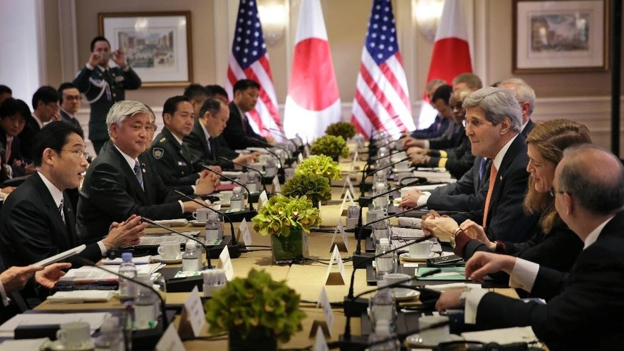 Japanese Foreign Minister Fumio Kishida, left, and Defense Minister Gen Nakatani, second from left, attend a meeting with U.S. Secretary of State John Kerry, third from right, and Secretary of Defense Ashton Carter, not visible, in New York, Monday, April 27, 2015. Japan and the U.S. foreign and defense ministers on Monday signed off on revisions to the U.S.-Japan defense guidelines, boosting their defense relationship to allow a greater Japanese role in global military operations with an eye on potential threats from China and North Korea. They are the first changes to the treaty allies'  joint strategy in 18 years. (AP Photo/Seth Wenig, Pool)