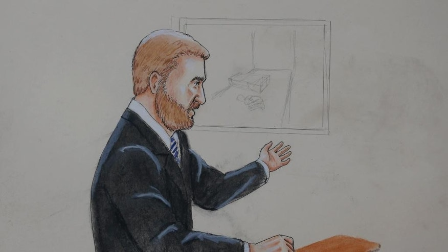 ADDS RESTRICTIONS _In this Monday, April 27, 2015 sketch by courtroom artist Jeff Kandyba, public defender Daniel King makes a point during the opening day of the trial for Aurora, Colo., theatre shooting suspect James Holmes Monday, April 27, 2015, in Centennial, Colo. The trial will determine if Holmes will be executed, spend his life in prison or be committed to an institution as criminally insane. (AP Photo/Jeff Kandyba)