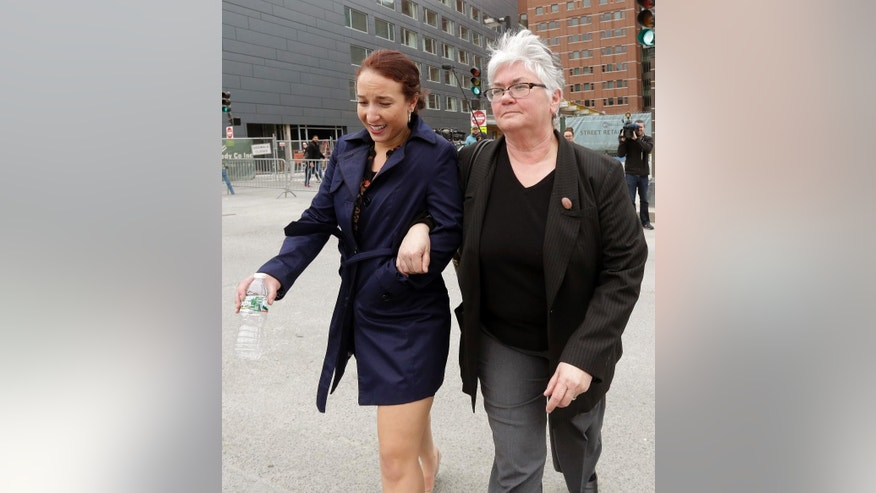Gina Crawford, left, a friend of Tamerlan Tsarnaev's widow Katherine Russell, leaves federal court in Boston after testifying Monday, April 27, 2015, during the penalty phase in the trial of Dzhokhar Tsarnaev. The woman at right is not identified. Dzhokhar Tsarnaev was convicted of the Boston Marathon bombings that killed three and injured 260 people in April 2013. Tamerlan Tsarnaev died during a firefight with police four days after the bombings. (AP Photo/Steven Senne)