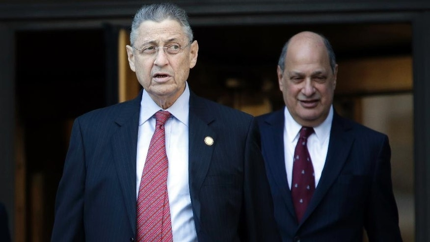 Former New York state Assembly Speaker Sheldon Silver, left, leaves court, Tuesday, April 28, 2015, in New York. A November 2 trial date has been set for a jury to hear the corruption case brought against Silver. (AP Photo/Mary Altaffer)