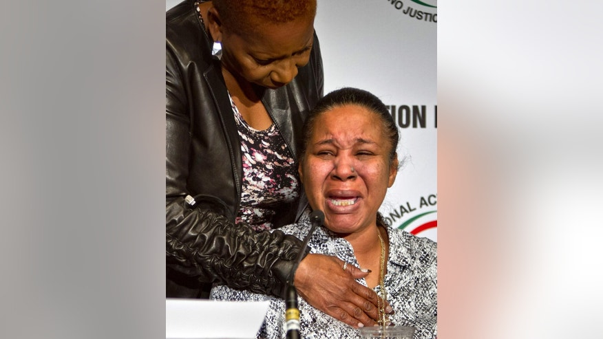 "FILE - In this April 8, 2015 file photo, Esaw Snipes, right, the wife of police victim Eric Garner, is comforted by moderator Iyanla Vanzant at a meeting of top civil rights leaders in New York. Garner told a crowd at a December march in Washington, D.C., that ""we are fighting not just for him but for everybody's future, for everybody's past, for everybody's present, and we need to make it strong.""  (AP Photo/Bebeto Matthews, File)"