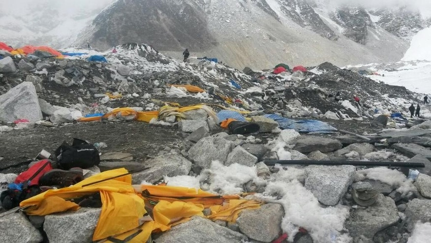 Shoes and camping gear lie strewn about after an avalanche hit the area on Saturday at Everest Base Camp, Nepal, Tuesday, April 28, 2015. An avalanche on Saturday, set off by the massive earthquake that struck Nepal, left more than a dozen people dead and dozens more injured. (AP Photo/Nima Namgyal Sherpa)