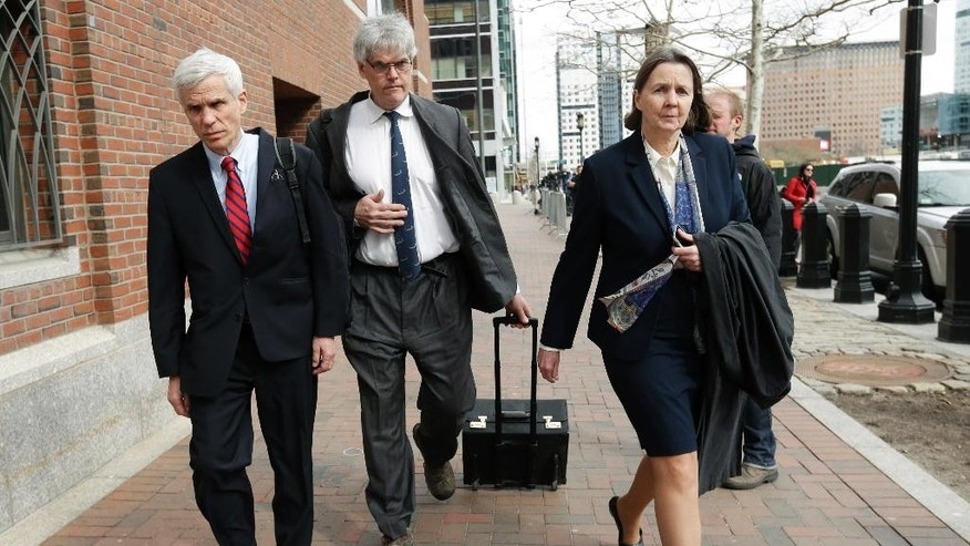 Defense attorneys, from left, David Bruck, Timothy Watkins and Judy Clarke, leave federal court in Boston at the end of the day's session Monday, April 27, 2015, during the penalty phase in the trial of Dzhokhar Tsarnaev. Tsarnaev was convicted of the Boston Marathon bombings that killed three and injured 260 people in April 2013. (AP Photo/Steven Senne)