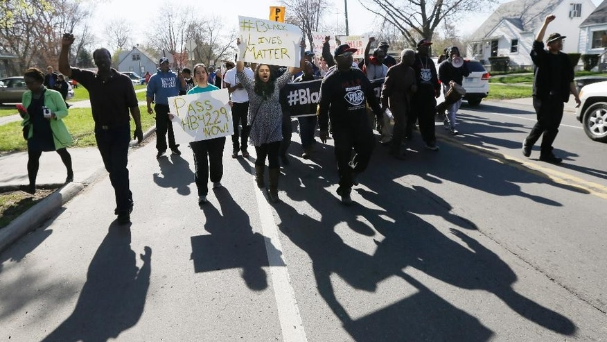People march on West Chicago in Detroit, Tuesday, April 28, 2015, in support of Terrance Kellom. Kellom was fatally wounded Monday by an U.S. Immigration and Customs Enforcement officer serving on a fugitive task force. (AP Photo/Carlos Osorio)