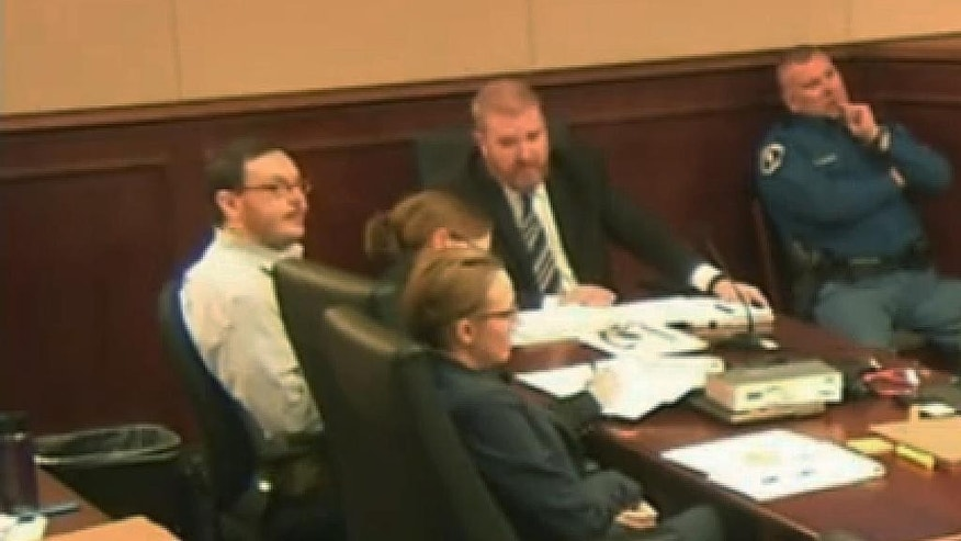FILE - In this April 27, 2015 file photo taken from video, Colorado movie theater massacre defendant James Holmes, far left, sits at the defense table at the opening of his trial in Centennial, Colo. The courtroom where the Colorado theater shooting trial is now unfolding is awash with emotion, as survivors recount the horrors of dodging gunfire and stumbling over loved ones' maimed bodies as they fled. (Colorado Judicial Department via AP, Pool)