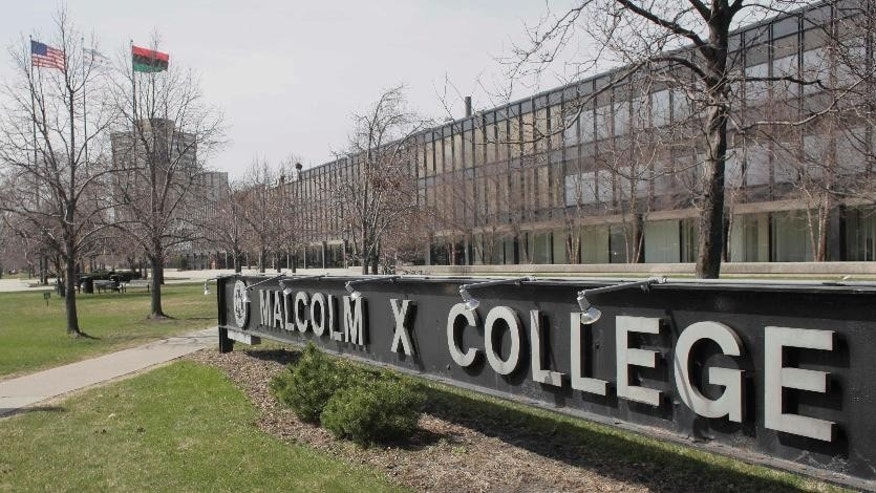 """FILE - This April 1, 2010 file photo shows Malcom X College in Chicago. A doctor has filed a lawsuit against City Colleges of Chicago, claiming he was fired in retaliation for raising questions about four unidentified, decomposing cadavers stored in boxes in a locked, un refrigerated closet. Dr. Micah Young filed the lawsuit Tuesday April 28, 2015 in Cook County Circuit Court. Young had been dean of the Health Sciences and Career Programs at Malcolm X College, one of seven colleges in the system. Young says he was fired Feb. 4 because he called attention to """"severely decomposed cadavers"""" that weren't properly identified and might cause workplace safety issues. He says the bodies had been stored at least 12 years. (AP Photo/M. Spencer Green, File)"""