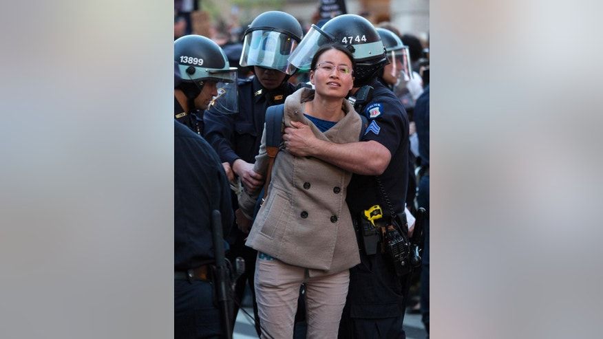 A person is arrested by police officers near Union Square, Wednesday, April 29, 2015, in New York. People gathered to protest the death of Freddie Gray, a Baltimore man who was critically injured in police custody. (AP Photo/Craig Ruttle)