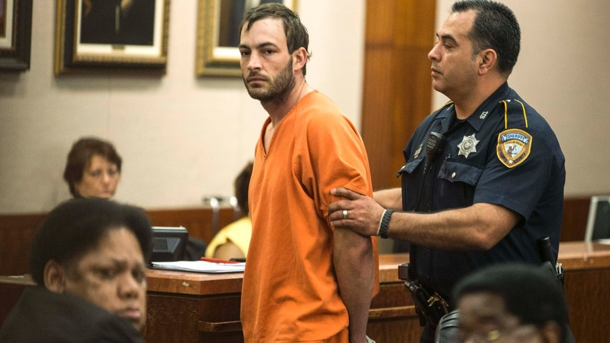 April 29, 2015: Blaine Boudreaux is escorted from the courtroom.