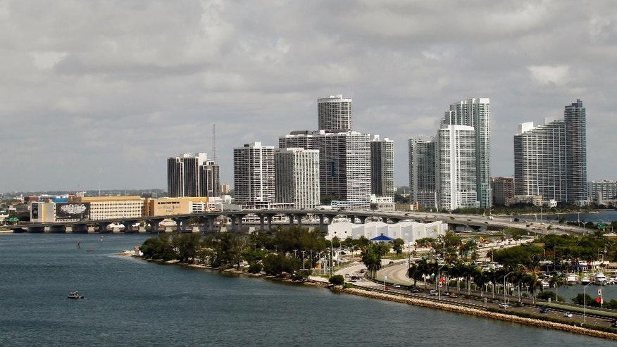 FILE - This, July 8, 2010, file photo, shows the Miami skyline. If South Florida seceded, Original Florida, which would be everything north of Orlando and Tampa, would have twice as many churches per capita as South Florida. South Florida would have seven times as many as synagogues. (AP Photo/Wilfredo Lee, File)