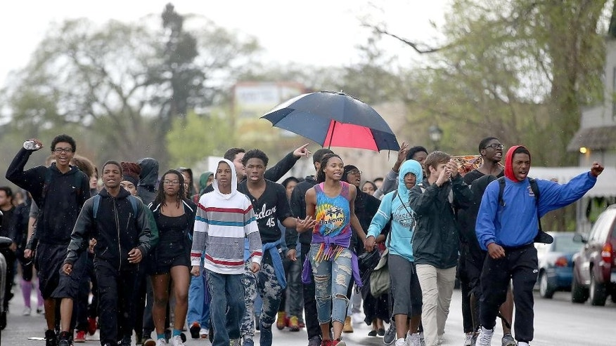 Students from Washburn and Southwest High Schools make their way down Nicollet Avenue toward Martin Luther King Park, Friday, May 1, 2015, in Edina, Minn, in support of protesters arrested in December at the Mall of America. (Elizabeth Flores/Star Tribune via AP)  MANDATORY CREDIT; ST. PAUL PIONEER PRESS OUT; MAGS OUT; TWIN CITIES LOCAL TELEVISION OUT