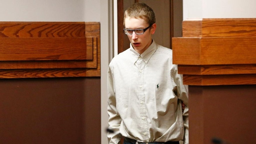 Jake Evans enters a Parker County courtroom for a plea hearing Thursday, April 30, 2015, in Weatherford, Texas. Evans pleaded guilty Thursday for killing his mother and 15-year-old sister inside the family's Parker County home in October 2012.  (Ron Jenkins/The Fort Worth Star-Telegram via AP, Pool)