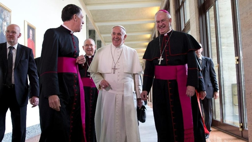 "Pope Francis, flanked by rector of the Pontifical North American College James F. Checchio, left, and President of the United States Conference of Catholic Bishops Joseph Edward Kurtz arrives at Rome's Pontifical North American College, Saturday, May 2, 2015. Pope Francis has praised the ""holiness"" and ""zeal"" of an 18th-century Franciscan missionary he'll make a saint when he visits the United States this fall but whom Native Americans in California contend brutally converted indigenous people to Christianity. Francis on Saturday praised the accomplishments and qualities of Rev. Junipero Serra during a homily at a Rome seminary training future priests from North America. (AP Photo/Andrew Medichini)"
