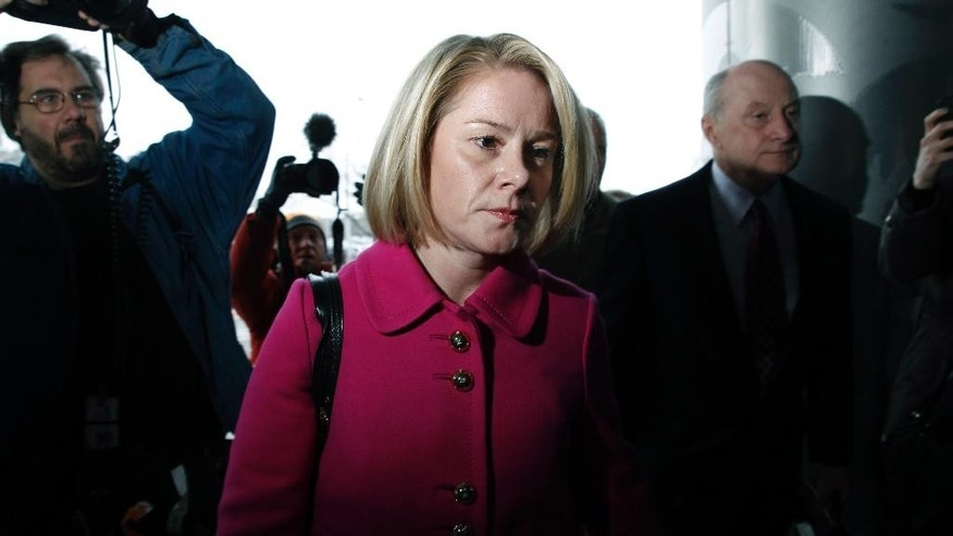 FILE - In this Tuesday, March 11, 2014, file photograph, New Jersey Gov. Chris Christie's former Deputy Chief of Staff Bridget Anne Kelly and her attorney Michael Critchley, right, arrive at court for a hearing in Trenton, N.J. David Wildstein, a former Christie ally, pleaded guilty Friday, May 1, 2015, to helping engineer traffic jams at the George Washington Bridge in 2013 and concocting a cover-up along with Kelly and Bill Baroni, who was Christie's top appointee at the Port Authority. (AP Photo/Mel Evans, File)