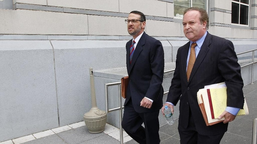 David Wildstein, left, and his attorney Alan Zegas, leave Martin Luther King Jr. Federal Courthouse in Newark, N.J. Friday, May 1, 2015. Wildstein, a former Port Authority appointee of New Jersey Governor Chris Christie, pleaded guilty on charges arising from a federal probe into traffic jams he ordered on the George Washington Bridge, allegedly on behalf of Gov. Christie. (AP Photo/Rich Schultz)