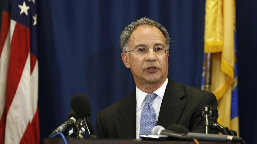 U.S. Attorney for New Jersey Paul J. Fishman announces that William E. Baroni and Bridget Anne Kelley were each charged by a federal grand jury at during a news conference at the federal building in Newark, N.J. Friday, May 1, 2015. Baroni, a former top official at the Port Authority and Kelley, a former member of Gov. Chris Christie's staff have been charged with a scheme to misuse Port Authority resources to facilitate and conceal the causing of traffic problems in Fort Lee to punish the borough's mayor for not endorsing the Governor's re-election. (AP Photo/Rich Schultz)