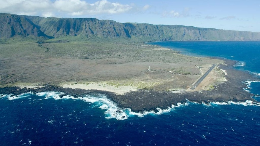 FILE -This Aug. 12, 2008, file photo, shows an aerial view of Kalaupapa Peninsula on Molokai, Hawaii. A handful of people with leprosy are still living full time on the isolated peninsula, but the National Park Service is already making plans to overhaul buildings and allow more visitors to the area when the last of the patients dies. (AP Photo/Hugh E. Gentry, File)