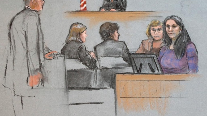 In this courtroom sketch, Raisat Suleimanova, right, is depicted testifying alongside an interpreter during the penalty phase in the trial of her cousin Dzhokhar Tsarnaev, center, Monday, May 4, 2015, in federal court in Boston. Tsarnaev was convicted of the Boston Marathon bombings that killed three and injured 260 people in April 2013. (Jane Flavell Collins via AP)