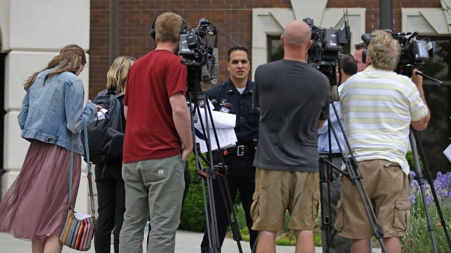 Lt. Craig Martinez with the Orem Police Department speaks during a news conference Monday, May 4, 2015, in Orem, Utah. Utah police have identified a 26-year-old man who they say was fatally shot by a bystander after struggling with a woman while trying to steal her car in Orem over the weekend. Orem Police say Taulagi Matafeo of Springville was shot in the chest after he lunged for a gun pointed by a 31-year-old Orem man who intervened in the carjacking. (AP Photo/Rick Bowmer)