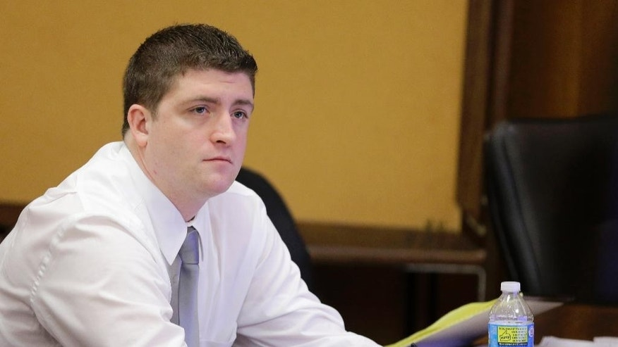 FILE - In this April 9, 2015, file photo, Cleveland police Officer Michael Brelo listens to testimony during his trial in Cleveland. Attorneys are scheduled to give closing arguments, Tuesday, May 5, 2015, in the trial of Brelo, charged in the deaths of two unarmed people in a 137-shot barrage of police gunfire. (AP Photo/Tony Dejak, Pool, File)