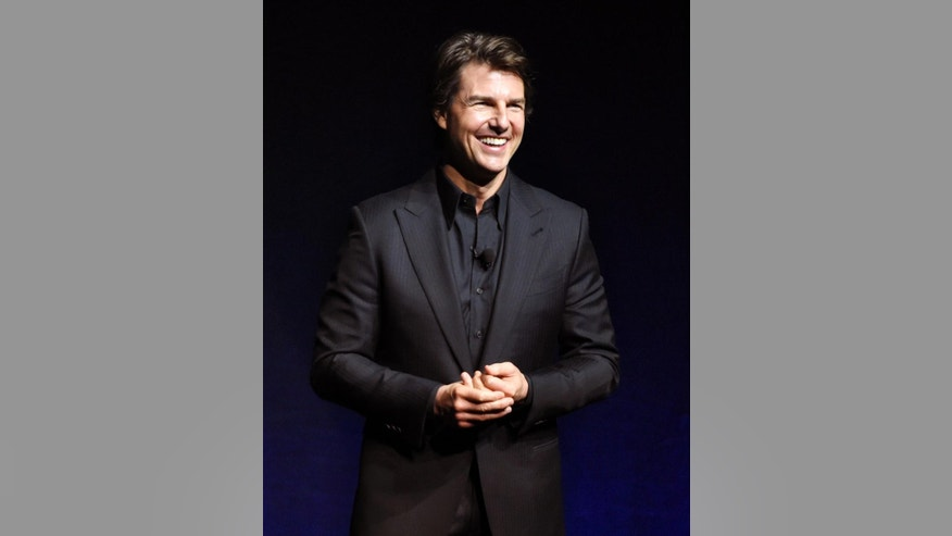 "FILE - In this April 21, 2015 file photo, Tom Cruise, star of the upcoming film ""Mission: Impossible - Rogue Nation,"" makes an appearance at the Paramount Pictures presentation at CinemaCon 2015 in Las Vegas. Cruise was also featured in the Alex Gibney documentary, ""Going Clear: Scientology and the Prison of Belief."" (Photo by Chris Pizzello/Invision/AP, File)"