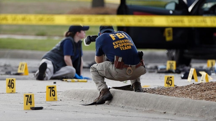 A delivery truck is parked in front of the Curtis Culwell Center parking lot Tuesday, May 5, 2015, in Garland, Texas.  A man whose social media presence was being scrutinized by federal authorities was one of two suspects in the Sunday shooting at this location that hosted a cartoon contest featuring images of the Muslim Prophet Muhammad. The Islamic State group on Tuesday claimed responsibility for the attack. (AP Photo/LM Otero)
