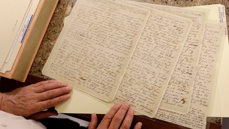 May 4, 2015: Bob Hirst, general editor of the Mark Twain Project, shows a letter from Twain to his brother Orion Clemens and sister-in-law Mollie Clemens from October 1865, at The Bancroft Library at the University of California Berkeley. (AP Photo/Jeff Chiu)