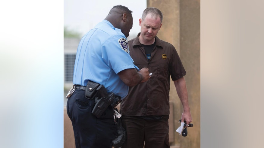 Jeff Hermansen speaks with an officer of the Rockford Police Department after rescuing a man who jumped into the Rock River, Tuesday, May 5, 2015, in Rockford, Ill. Authorities are praising the heroism of Hermansen, who risked his life to rescue a man who jumped into a river in Illinois on Tuesday. (Sunny Strader/Rockford Register Star via AP)  MANDATORY CREDIT