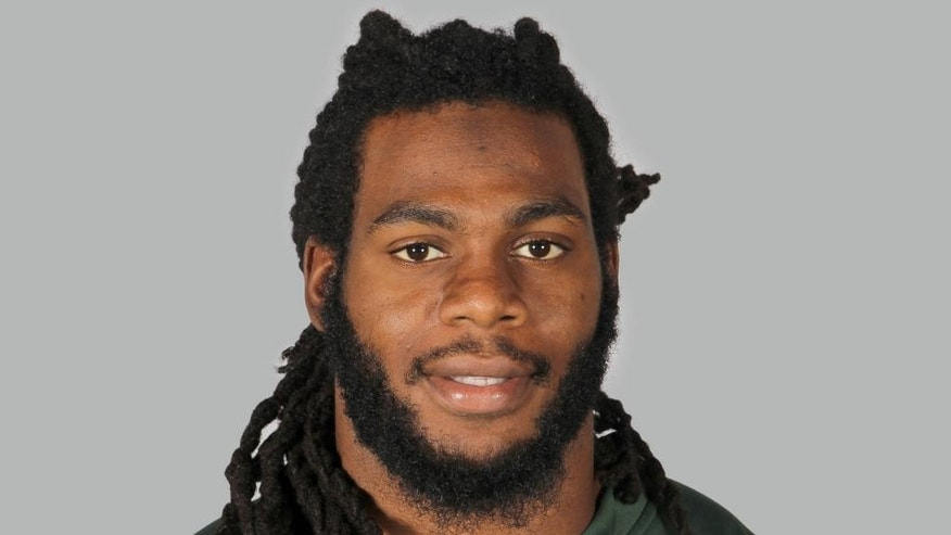 "FILE - A June 16, 2014, file photo is of New York Jets linebacker Jermaine Cunningham in Forham Park, N.J.  When Cunningham appears in a New Jersey courtroom, he'll be the most recognizable defendant yet facing charges over ""revenge porn."" The case comes amid a national push to punish jilted lovers and others who distribute racy photos often taken before a relationship fell apart.  (AP Photo)"
