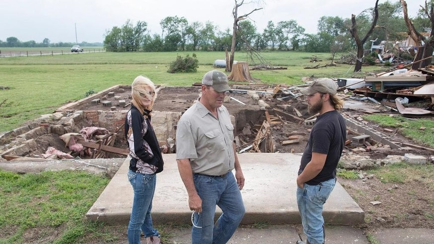 Neighbors of Craig Foraker check out his property after a tornado devastated the area near Bentley, Kan., Wednesday May 6, 2015. A swath of the Great Plains is under a tornado watch Wednesday, including parts of North Texas, Oklahoma, Kansas and Nebraska. (Travis Heying/The Wichita Eagle via AP) LOCAL TELEVISION OUT; MAGS OUT; LOCAL RADIO OUT; LOCAL INTERNET OUT