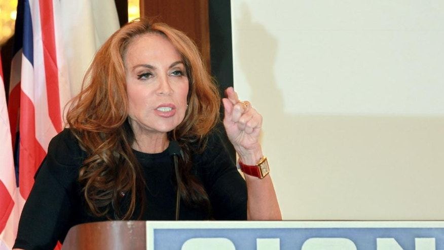 "In this Sept. 11, 2012 photo, blogger and activist Pamela Geller speaks at a conference she organized entitled ""Stop Islamization of America,"" in New York. The New York Police Department met with Geller on Wednesday, May 6, 2015, after a threat against her was discovered on a website related to the Islamic State group. NYPD spokesman Stephen Davis said that the department will do a ""comprehensive threat assessment"" to decide whether it's credible enough to require security for Geller. (AP Photo/David Karp)"