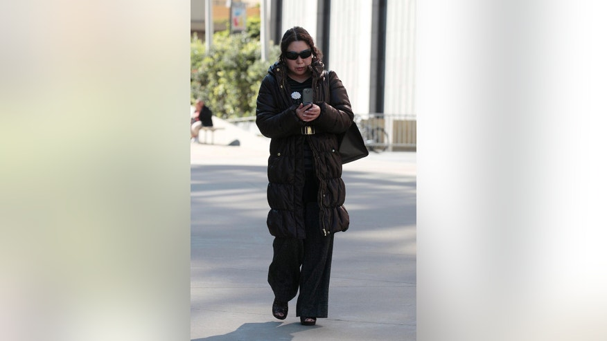FILE - In this March 8, 2012 file photo, Christina Liew walks out of a federal courthouse in San Francisco. On May 5, 2015, Liew pleaded guilty to conspiracy to tamper with evidence after being accused with her husband and former DuPont employees of stealing and selling trade secrets to China for a highly coveted whitener used in cars, Oreo cookies and a variety of other products. (AP Photo/Jeff Chiu, file)
