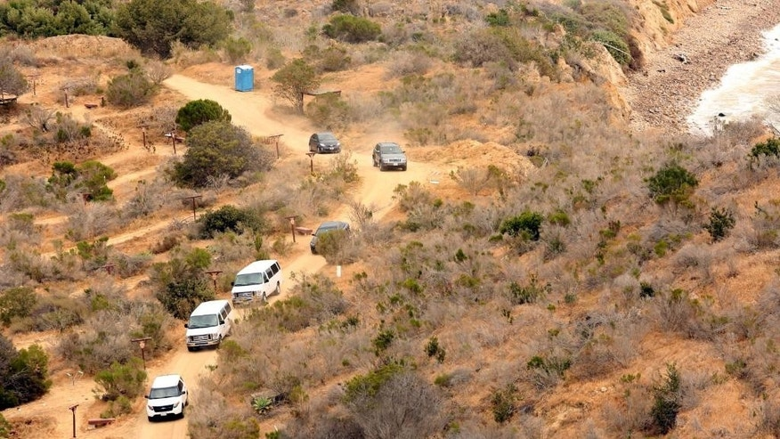 In this aerial photo, Los Angeles County Sheriff motorcade delivers Jurors to the archery range near Inspiration Point in the trial of Cameron Brown, Thursday, May 7, 2015, in Rancho Palos Verdes, Calif. The third trial for Brown who is accused of killing his 4-year-old daughter, who plunged to her death off a cliff into the Pacific Ocean. (Al Seib/Los Angeles Times via AP, Pool)