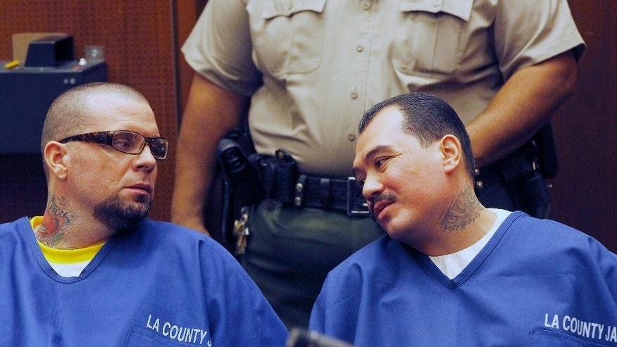 FILE - In this Feb. 20, 2014 file photo, defendants Marvin Norwood, left, and Louie Sanchez appear during a hearing in Los Angeles. Sanchez, w ho smirked as he was sentenced in the savage beating of a San Francisco Giants fan outside Dodger Stadium wants a federal judge to spare him from another lengthy prison sentence for an unrelated gun crime. Sanchez's hand-written letter prays for mercy in the crime discovered as police investigated the 2011 opening day attack that left Bryan Stow with permanent brain damage. (AP Photo/Nick Ut, File )