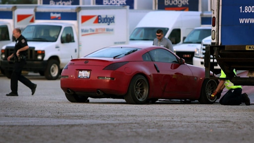 In this May 5, 2015, photo, a 2007 Nissan 350ZX is loaded on to the back of tow tuck after it was found in the St. Louis suburb of Hazelwood, Mo. The body of Taylor Clark, an Illinois college student who went missing while trying to sell his sports car on Craigslist, was found Tuesday night near a driving school not far from where his abandoned vehicle, the 2007 Nissan 350ZX, was found according to Tim Fagan, the deputy commander of the Major Case Squad of Greater St. Louis and lead investigator. Authorities continue to investigate the slaying of Taylor Clark. (David Carson/St. Louis Post-Dispatch via AP)  EDWARDSVILLE INTELLIGENCER OUT; THE ALTON TELEGRAPH OUT; MANDATORY CREDIT