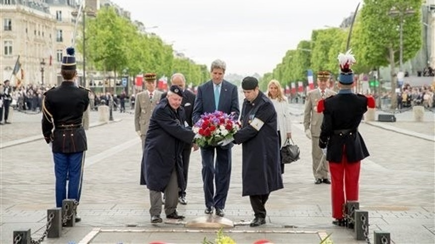 U.S. Secretary of State John Kerry lays a wreath at the Tomb of the Unknown Soldier in Paris, France, Friday, May 8, 2015, during France's 70th anniversary of VE Day.  Kerry has also visited Sri Lanka, Somalia, Djibouti, Kenya, and Saudi Arabia on his trip. (AP Photo/Andrew Harnik, Pool)