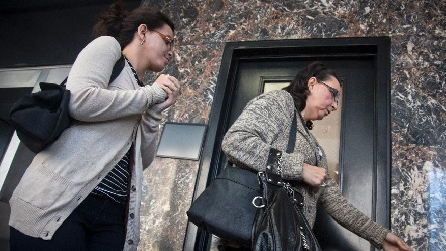 Becky Hernandez, left, daughter of Pedro Hernandez, and her mother Rosemary Hernandez, right, leave court during a break during jury deliberations in the trial of Pedro Hernandez at Manhattan Supreme Court in New York on Friday, May 8, 2015. After 18 days of deliberation, the trial of a man accused in the 1979 disappearance of first-grader Etan Patz ended Friday in a jury deadlock, leaving one of the nation's most wrenching missing-children cases still unresolved after nearly two generations. (AP Photo/Bebeto Matthews)