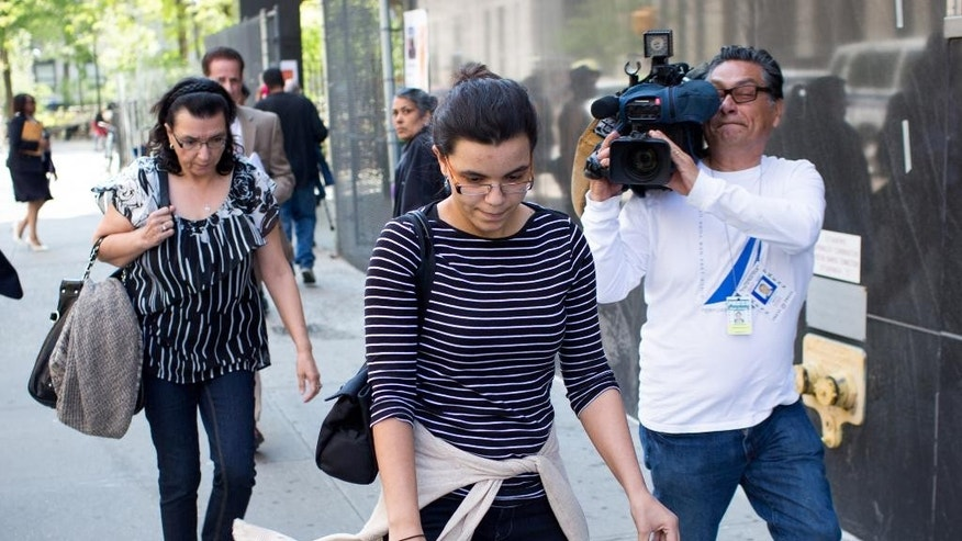Rosemary Hernandez, left, wife of the Pedro Hernandez, and her daughter Becky Hernandez, leave court after a mistrial was declared in Perdro Hernandez's murder trial, Friday, May 8, 2015 in New York. Pedro Hernandez  is accused of kidnapping and killing 6-year-old Etan Patz in 1979. (AP Photo/Kevin Hagen)
