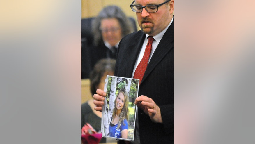 FILE - In this Feb. 23, 2015 file photo, Assistant Attorney Gen. Donald Macomber hold up a picture of Nichole Cable during opening arguments on the first day of Kyle Dube's trial in Bangor, Maine. Dube, convicted in March of kidnapping and murdering her, faces sentencing Friday, May 8, 2015, in Bangor. (AP Photo/The Bangor Daily News, Gabor Degre, Pool, File)