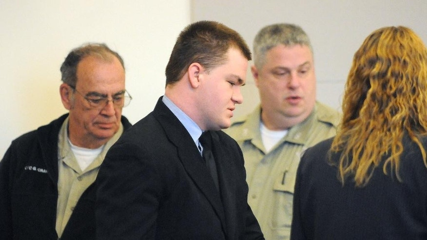Kyle Dube is escorted into the courtroom at the Penobscot Judicial Center before his sentencing on Friday, May 8, 2015 in Bangor, Maine. Dube, who used a phony Facebook profile to lure a teenage girl to her death was sentenced to 60 years in prison. A jury convicted the 22-year-old in March of kidnapping and murder of 15-year old Nichole Cable. (Gabor Degre/The Bangor Daily News via AP, Pool)