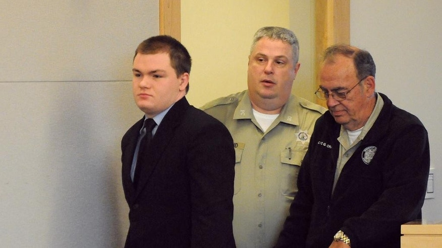 Kyle Dube is escorted into the courtroom at the Penobscot Judicial Center in Bangor before his sentencing Friday, May 8, 2015 in Bangor, Maine. Dube, who used a phony Facebook profile to lure a teenage girl to her death was sentenced to 60 years in prison. A jury convicted the 22-year-old in March of kidnapping and murder of 15-year old Nichole Cable. (Gabor Degre/The Bangor Daily News via AP, Pool)